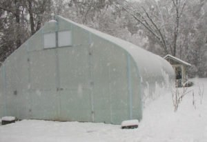 Greenhouse with Polycoolite glazing in the snow
